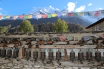 Mani wall and prayer flags over looking Annapurna III
